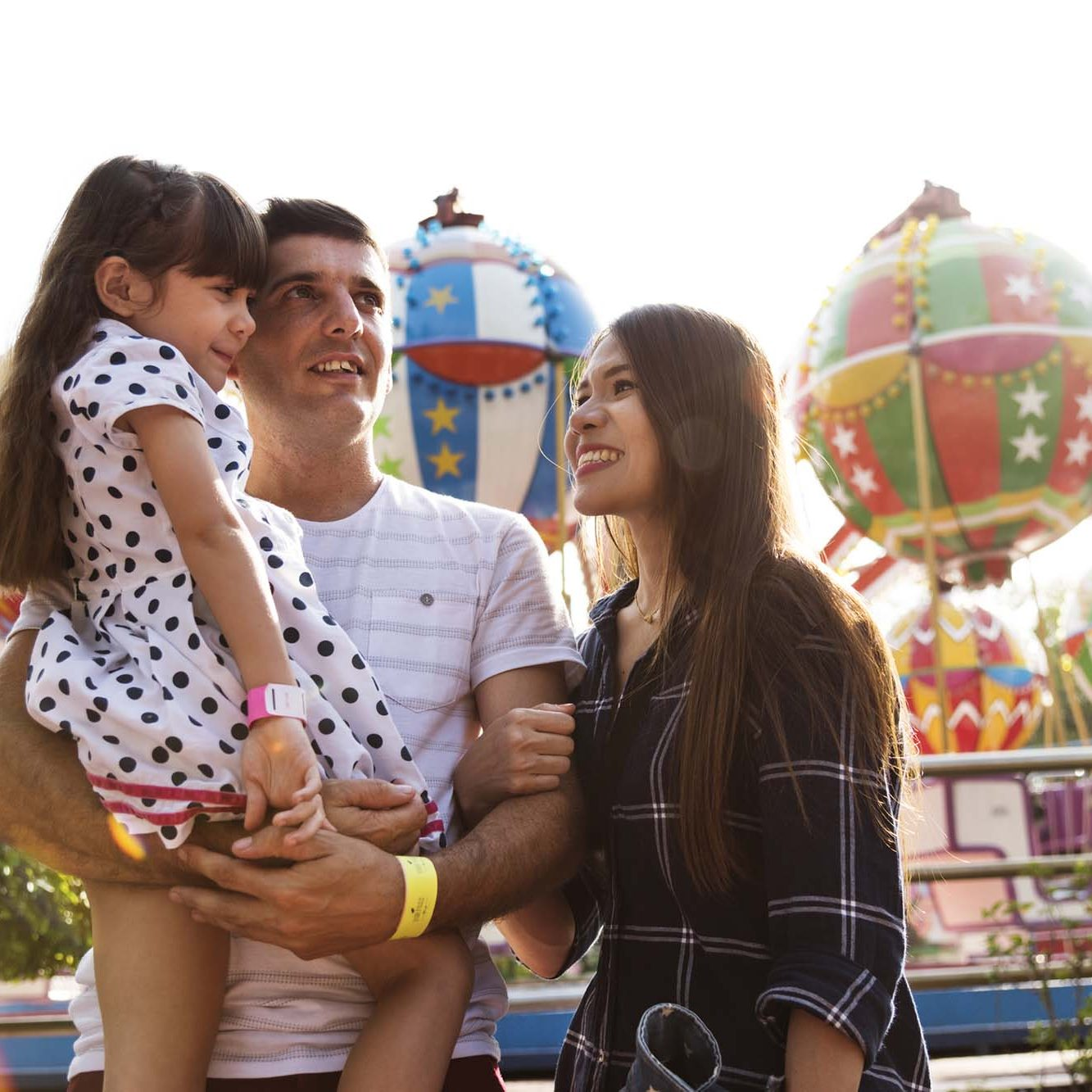 Happy family on holiday at the funfair